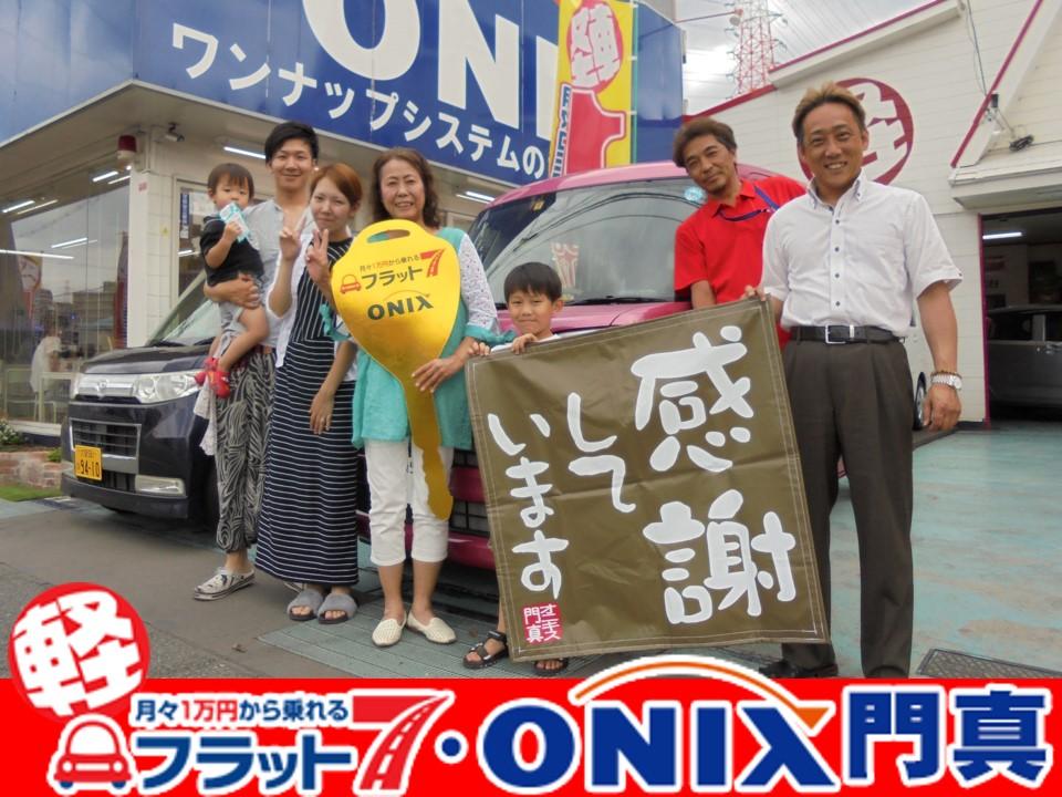 新車『スペーシア・ピンク』ご購入の守口市在住S様の笑顔です。