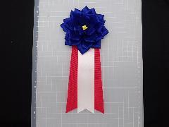 胸につける花リボンバラ・記章・徽章(中・花径10cm)紺