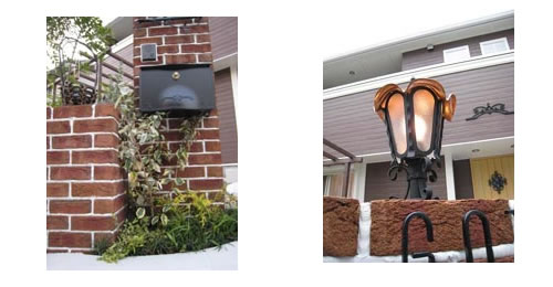 レンガ積みの門柱とアイアン製の灯り