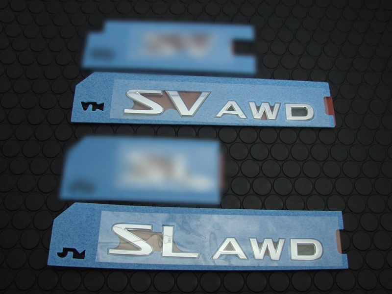 SV/SL AWD REAR EMBLEM