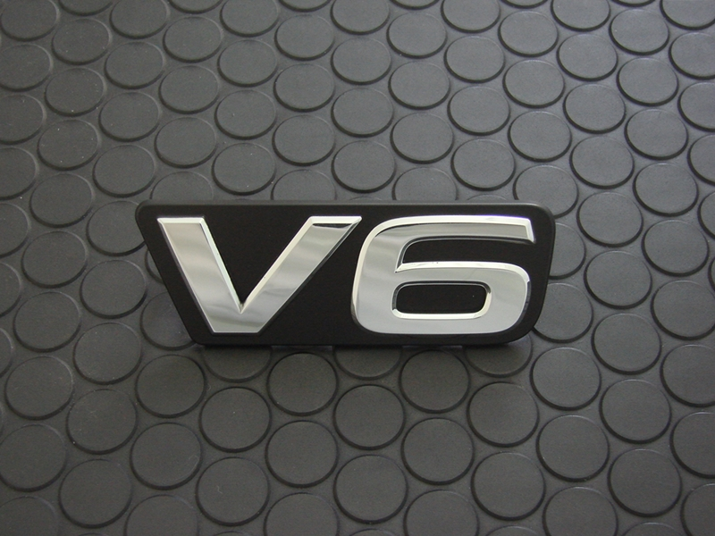 FRONT V6 EMBLEM