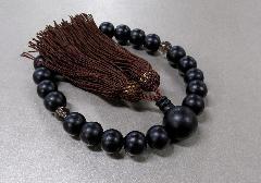 □男性用片手念珠 素挽黒檀2天茶水晶仕立 人絹頭房