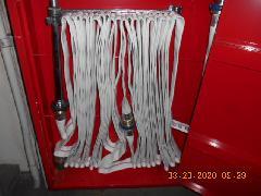 さいたま市の倉庫で誘導灯、屋内消火栓設備のホースの交換作業